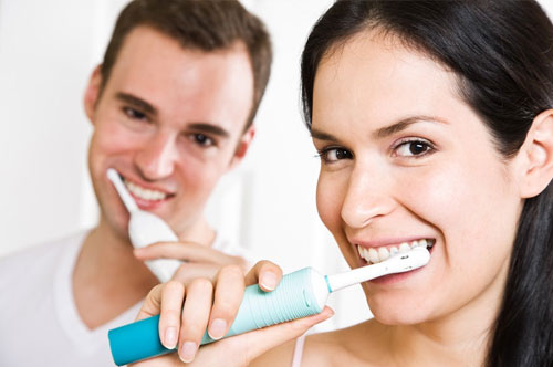 Girl and Guy Brushing their teeth together | Decay Prevention in Friendly Smiles Center in Mount Laurel, NJ - Dr. Robert Chase
