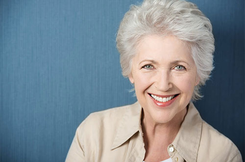 Elderly Woman with a Confident Smile | Dental Crowns and Bridges in Friendly Smiles Center in Mount Laurel, NJ - Dr. Robert Chase