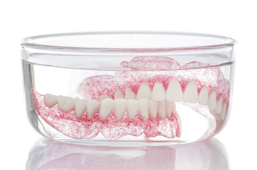 Replica of Upper and Lower Dentures Soaked in Water | Dentures in Friendly Smiles Center in Mount Laurel, NJ - Dr. Robert Chase