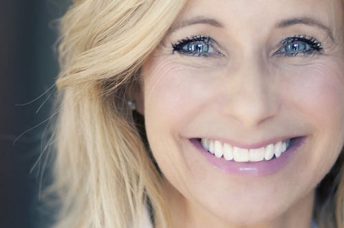 Glowing Middle-Aged Woman Brightly Smiling   Full-Mouth Reconstruction in Friendly Smiles Center in Mount Laurel, NJ - Dr. Robert Chase