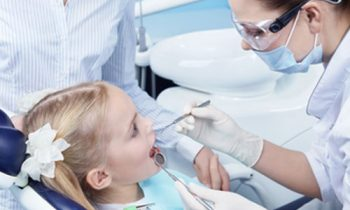 Young Girl Having a Dental Examination with her Dentist   Preventative Orthodontics for Kids in Friendly Smiles Center in Mount Laurel, NJ - Dr. Robert Chase