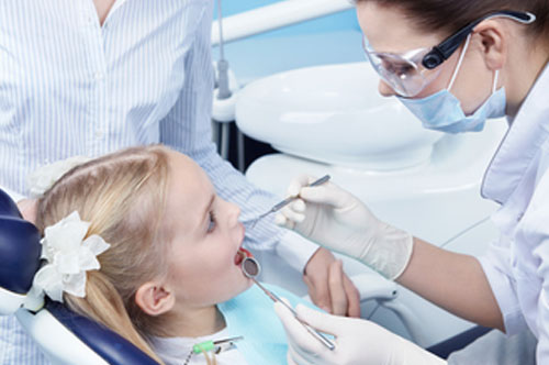 Young Girl Having a Dental Examination with her Dentist | Preventative Orthodontics for Kids in Friendly Smiles Center in Mount Laurel, NJ - Dr. Robert Chase