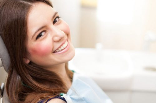 Pretty Lady Smiling while at a dental chair | Dental Anxiety Solution in Friendly Smiles Center in Mount Laurel, NJ - Dr. Robert Chase