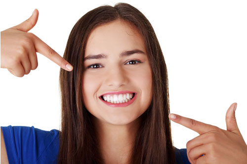 Happy Young Lady with Her Teeth | Root Canals in Friendly Smiles Center in Mount Laurel, NJ - Dr. Robert Chase