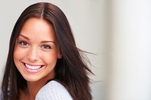 Confident Lady Smiling Brightly | Smile Makeover | Friendly Smiles Center in Mount Laurel, NJ - Dr. Robert Chase