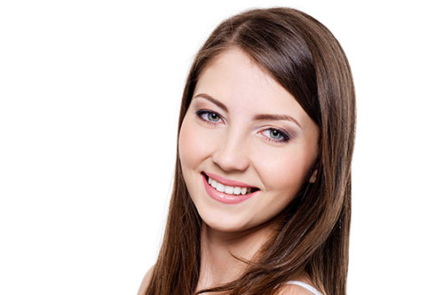 Mature-Looking Woman Shwoing a Simple Smile | Smile Makeover | Friendly Smiles Center in Mount Laurel, NJ - Dr. Robert Chase